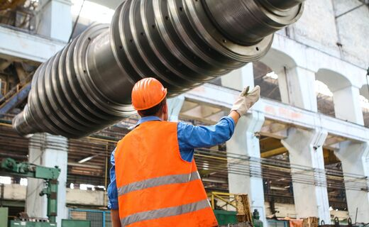 Man standing near gray metal equipment 2760243